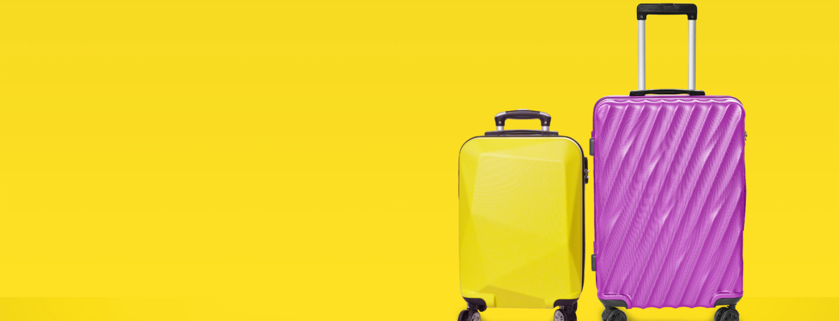 Two suitcases on a yellow background
